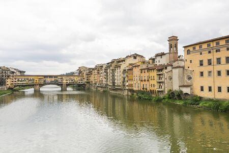 river arno: Florence,Italy-August 26,2014:view of ponte vecchio over the river Arno during a cloudy day Stock Photo