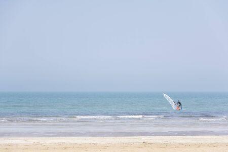 rimini: Rimini,Italy-April 12,2015:A boy windsurfers at sea near Rimini during a sunny day. Stock Photo