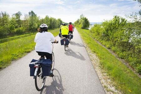 Wachau ValleyAustriaMay 82015: People are riding at Bcycle cycle path near danube river in Austria during a sunny day