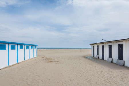 rimini: View of the colored Rimini cabin on the beach in front the Rimini sea during a sunny day.