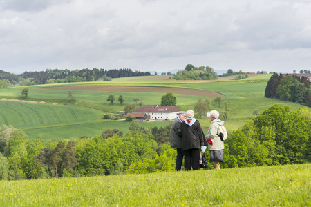 military invasion: Mauthausen, Austria-May 10.2015: a group of ex-deportee observes the landscape around the camp of Mauthausen where he was imprisoned more than seventy years ago during the celebration of the anniversary of the liberation of the camp.
