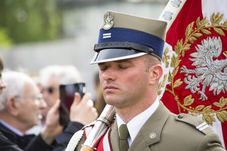 Mauthausen, Austria-May 10.2015: military celebration of the Mauthausen camp liberation by all the countries involved paying tribute to the fallen through military parades and floreal wreaths on monuments during a sunny day.