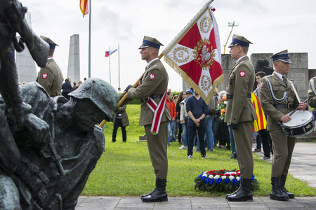 perpetrator: Mauthausen, Austria-May 10.2015: military celebration of the Mauthausen camp liberation by all the countries involved paying tribute to the fallen through military parades and floreal wreaths on monuments during a sunny day.