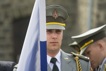 anti war: Mauthausen, Austria-May 10.2015: military celebration of the Mauthausen camp liberation by all the countries involved paying tribute to the fallen through military parades and floreal wreaths on monuments during a sunny day.