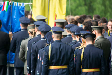 military invasion: Mauthausen, Austria-May 10.2015: military celebration of the Mauthausen camp liberation by all the countries involved paying tribute to the fallen through military parades and floreal wreaths on monuments during a sunny day.