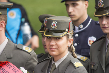 concentration camp: Mauthausen, Austria-May 10.2015: military celebration of the Mauthausen camp liberation by all the countries involved paying tribute to the fallen through military parades and floreal wreaths on monuments during a sunny day.