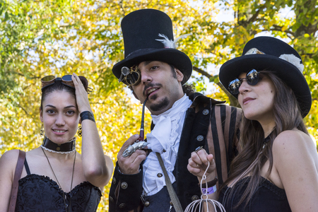 manga style: lucca,Italy-october 31,2015:people dressed with cartoons and heroes costumes  pose for a photo at the comic fair in Lucca During a sunny day. Editorial