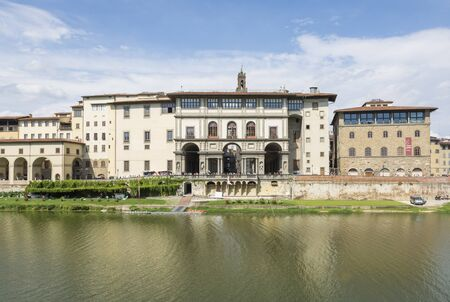 florence italy: Florence, Italy August 26.2014: a picturesque view of the Uffizi Gallery and the Arno River in Florence-Italy During a sunny day.