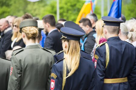 floreal: Mauthausen, Austria-May 10.2015: military celebration of the Mauthausen camp liberation by all the countries involved paying tribute to the fallen through military parades and floreal wreaths on monuments during a sunny day.