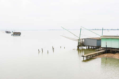 fishing huts: fishing huts on the sea near the city of Comacchio in Italy during a cloudy day