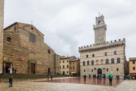 town square: Montepulciano,Italy-April 23,2016:people stroll under the rain in the town square of Montepulciano during a cloudy day. Editorial