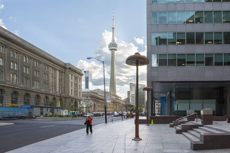 building cn tower: Toronto,Canada-august 1,2015:view of the CNN towers in Toronto during a sunny day from une of the central street of the city.
