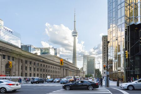 building cn tower: Toronto, Canada-august 1, 2015: view of the CNN towers in Toronto during a sunny day from une of the central street of the city.