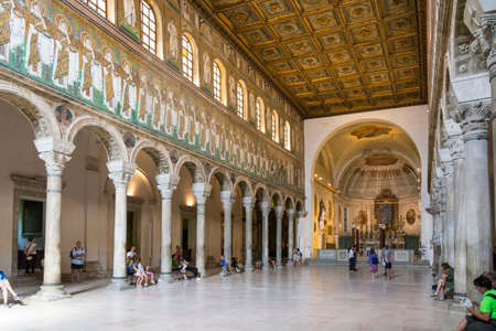 ravenna: Ravenna,Italy-august 21,2015:people visit the interior of San Appollinare nuovo church in Ravenna-Italy,during a summer day.