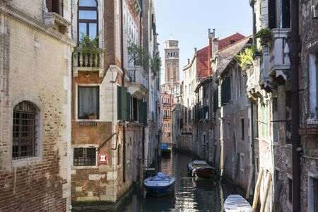 gondoliers: Venice, Italy-August 17.2014: view of one of the many canals That Cross, Venice During a sunny dau.