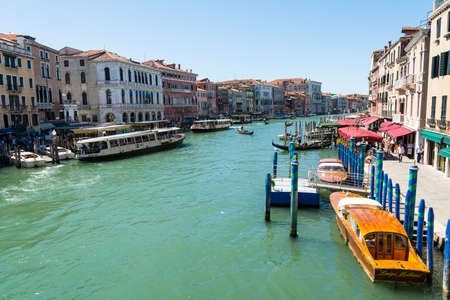 gondoliers: Venice,Italy-August 17,2014:view from hight of grand canal and boat in Venice during a summer day. Editorial