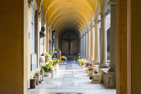 monumental cemetery: Bologna,Italy-december 7,2016:Arcade inside the monumental cemetery of the Certosa di Bologna during a sunny day.