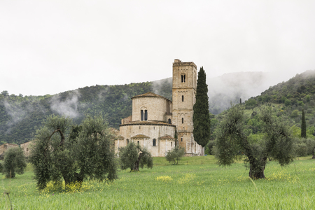 abbazia: Pienza,Italy-April 24,2016:View of the famous church on saint Antimo in the Tuscany countriside during a cloudy day.