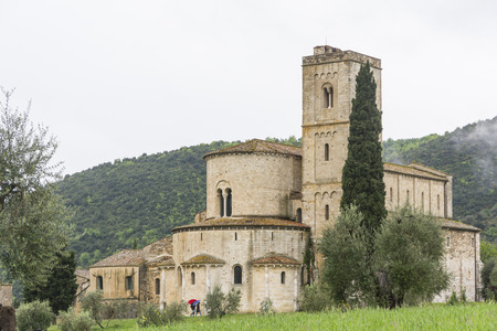 sant'antimo: Pienza,Italy-April 24,2016:View of the famous church on saint Antimo in the Tuscany countriside during a cloudy day.