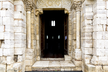antimo: Pienza,Italy-April 24,2016:Main entrance of the saint Antimo Abbey in Tuscany-Italy during a cloudy day. Editorial