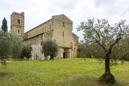antimo: Pienza,Italy-April 24,2016:View of the famous church on saint Antimo in the Tuscany countriside during a cloudy day.
