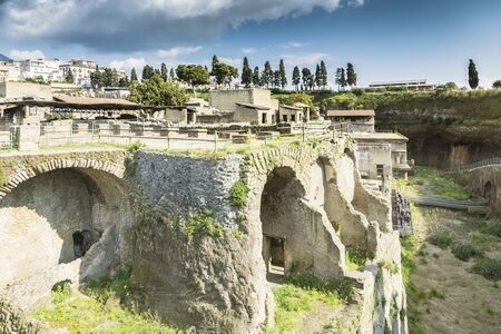 Ercolano, Italy- March 26, 2016: People visit Herculaneum archeological site near Naples during a summer day.
