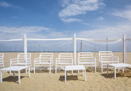 Rimini,Italy-April 17,2015:chairs and beach chairs on Rimini beach during a sunny day Stock Photo