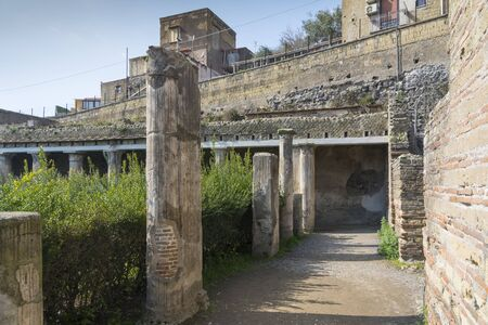Ercolano, Italy- March 26, 2016: Columns inside the Herculaneum archeological site near Naples during a summer day.