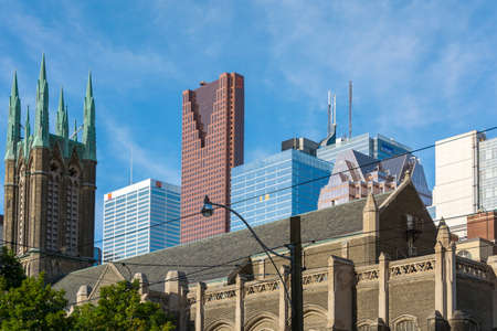 Toronto,Canada-august 2,2015: church and skyscrapers on the streets of the suburbs of Toronto during a sunny day Editorial