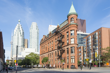 Toronto, Canada - August 2, 2015: view of the Gooderham Building (the Flatiron Building) in downtown Toronto,with some modern buildings and skyscrapers in the background during a sunny day. Editorial