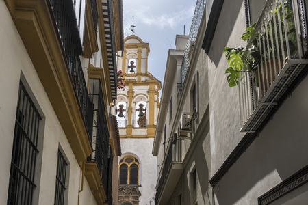 seville: Sevilla,Spain-august 7,2017:facade of the Parish of Santa Cruz in Sevilla during a summer day.