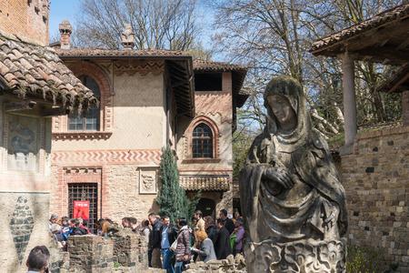 Grazzano Visconti,Italy-April 2,2018:People visit the historical village of Grazzano Visconti,neo-gothic village near Piacenza, Italy during a sunny day Editorial
