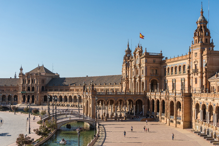 Seville,Spain-august 8,2017:tourists stroll and admire the famous plaza de Espana in Seville during a sunny day