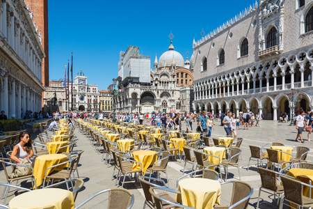 Venice,Italy -August 17,2014:Tourists visiting the famous Piazza San Marco in Venice during a sunny day Editorial
