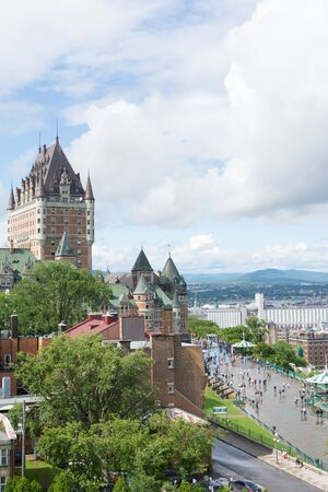 Quebec City, Canada - August 6, 2015:View of    the famouse Frontenac castle in Quebec City from parc du Bastion de la Reine a during cloudy morning.