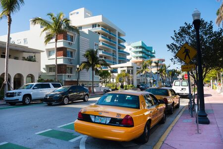 Miami,USA-march 15,2018:taxi on the famous Ocean drive in Miami during a sunny day