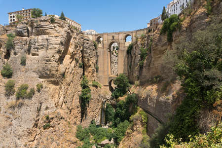 Ronda, Spain-august 10, 2017: view of the old bridge that divides the old city from the new one during a sunny day. 新闻类图片