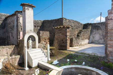 Pompeii, Italy-March 27, 2016: Columns and ruins inside the Pompeii archeological site near Naples during a summer day.