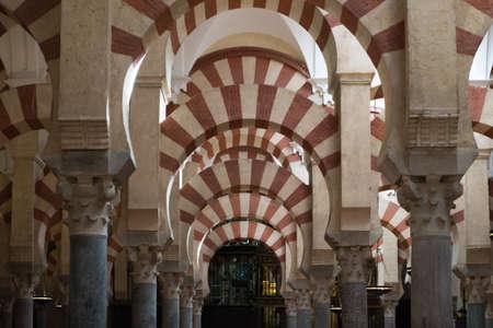 Cordoba, Spain-august 11, 2017: people admire the columns inside the beautiful Mezquita of Cordoba