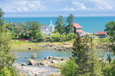 Port au Persil, Canada - August 8, 2015: View of the small town Port au Persil in Canada during a sunny day