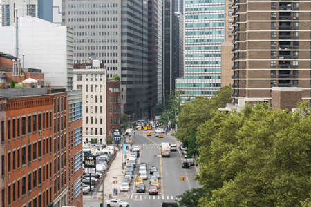 New York City, USA - August 6, 2019: Daily life in New York city during a cloudy day.Here a view of traffic and yellow taxis Redactioneel