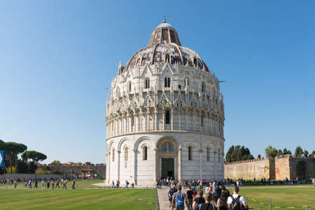Pisa, Italy-October 21, 2018: view of the famous leaning tower and the medieval cathedral located in the famous square of miracles in Pisa