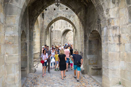Carcassonne, France-august 15,2016: people visit the famous fortified medieval city of Carcassone during a sunny day