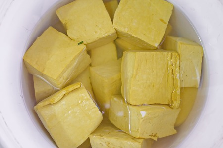 Raw cube tofu soaked in salty water