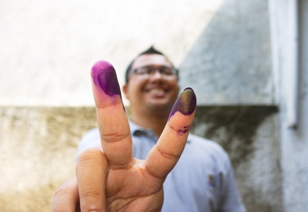 Man show his marked finger after vote