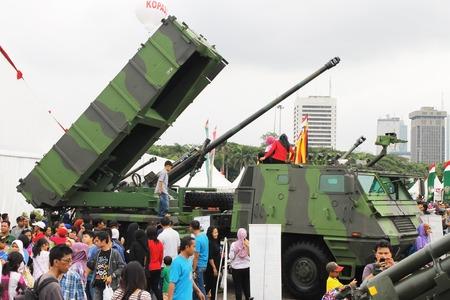 mk: Jakarta, Indonesia - December 13, 2014: Visitors look at Astros II mk 6 multiple launcher rocket system vehicle