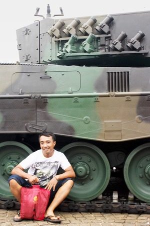 adult indonesia: Jakarta, Indonesia - December 13, 2014: Man crouch beside new Leopard tank that bought from Germany by the Indonesian National Armed Forces Editorial