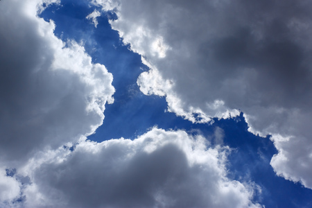overcast: Blue sky seen through gaps in the clouds during overcast Stock Photo