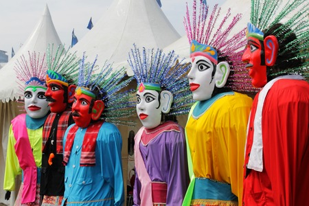 Ondel-ondel is a traditional big doll from Betawi's culture, a Jakarta's traditional culture that used in exorcise ritual in the past, but in modern days it used to entertain people. The red face is the man  The white face is the woman. It's all made from