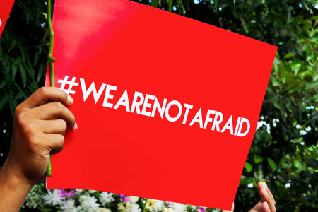 counteract: Red leaflet printed with a hashtag letter to invite peoples to not afraid.